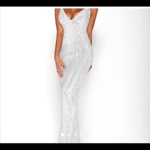 A beautiful stretchy bright silver formal Gown.